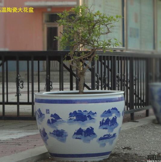 铁油桶做花盆图片